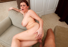 Sara Stone - Sara Stone in Housewife 1 on 1: Wife, Chair, Living room, Ottoman, Big Tits, Blow Job, Brunette, Cum on Tits, Curvy, Natural Tits, POV, Titty Fucking